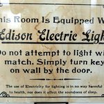 Signs in hotels when electric bulbs were first installed