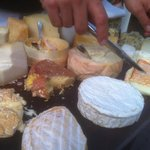 Fine selection of cheeses presented by a knowledgeable steward.