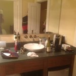 sink area too far back on vanity for shaving.  coffee maker and fridge (under vanity) in bath as