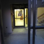 Open doorway leading to second-floor stairs