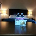 Complimentary water bottle and cookie