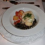 Monkfish served on a ragout of cherry tomatoes with thyme and wild rice