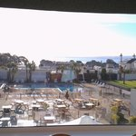The outdoor pool with the sea behind
