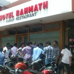 People patiently waiting outside during lunch hour to have a go at the beef biriyani