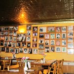 Dining room wall with photos