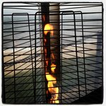 A view of the ocean through the heater lamps at the Beach Bar.