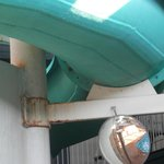 One of several rusty areas on waterslide that need cleaning and painting