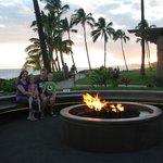 Fire circle near ocean at sunset