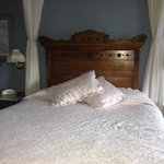 The lovely antique bed.
