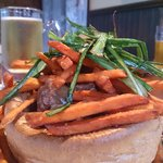 Beef Stew served in a yorkshire pudding bowl with Sweet potato fries.