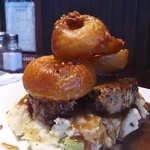 Irish Meatloaf with mash potatos and three home battered onion rings.