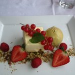 vanilla cheesecake with pistachio ice-cream and red berries