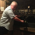 Steven, owner of the Old Shoulder of Mutton, showing guests how to wind the 300+ year old clock.