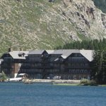 View of Many Glacier Lodge from boat on Swift Current Lake