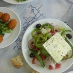 Horiatiki (Greek salad) and fried cheese with crumbles