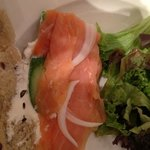smoked salmon cucumber onion cream cheese on nut bread with salad