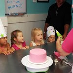My daughter's 5th birthday at Simply Cupcakes - watching her birthday cake get decorated!