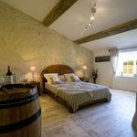 la chambre Vignes avec une vue Panoramique sur les vignes du château TARIS