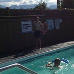 Boys in the pool.  Note mountains in distance.