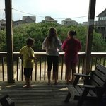 Kids on the balcony of the cottage.
