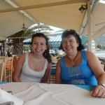 My daughter and me at a table by the sea at Armirali