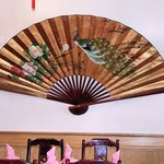 On another wall, a beautiful large fan with lighting behind. Superb effect!