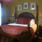 Beautiful high bed. Room is pitch black when curtains are drawn.