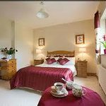 Double bedroom en-suite with a view of the garden and The River Moy