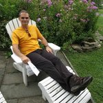 My husband relaxing in the Adirondack chairs outside