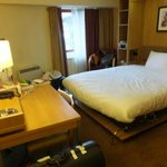 Bedroom with foldable double bed and working desk