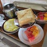 breakfast, omelet, fruits, tea and toast
