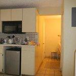 Kitchenette, hallway to double sink vanity and bathroom