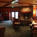 Fireplace kounge by coffee bar.