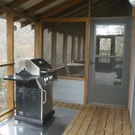 A covered porch and grill