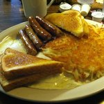 Two eggs, over easy, sausage links, hash browns and toast