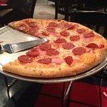"16"" inch ham & pepperoni pizza."