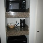 Microwave and small fridge in room