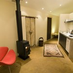 Upper studio woodheater and kitchen