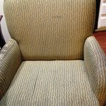 soiled and torn chair
