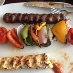 ground beef and chicken skewers with grilled vegetables