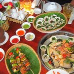 Marinated grilled seafood and sauces