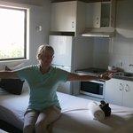 Inside chalet room, bed + kitchen area