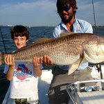 Captain Brandon and Jerry with the first Redfish of the day!