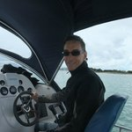 My husband at the helm