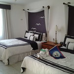 Our room no 1 with 2 queen size beds.