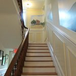 Stairway leading upstairs from main Parlor.