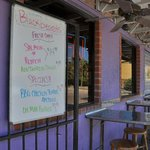 Outside seating and menu on the front porch.