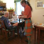 Alan serving breakfast in his kilt