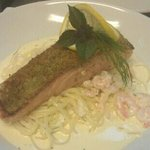 herb crusted salmon with crab and prawn linguine