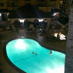 View from the 3rd floor at night looking down to the pool and jacuzzi area!